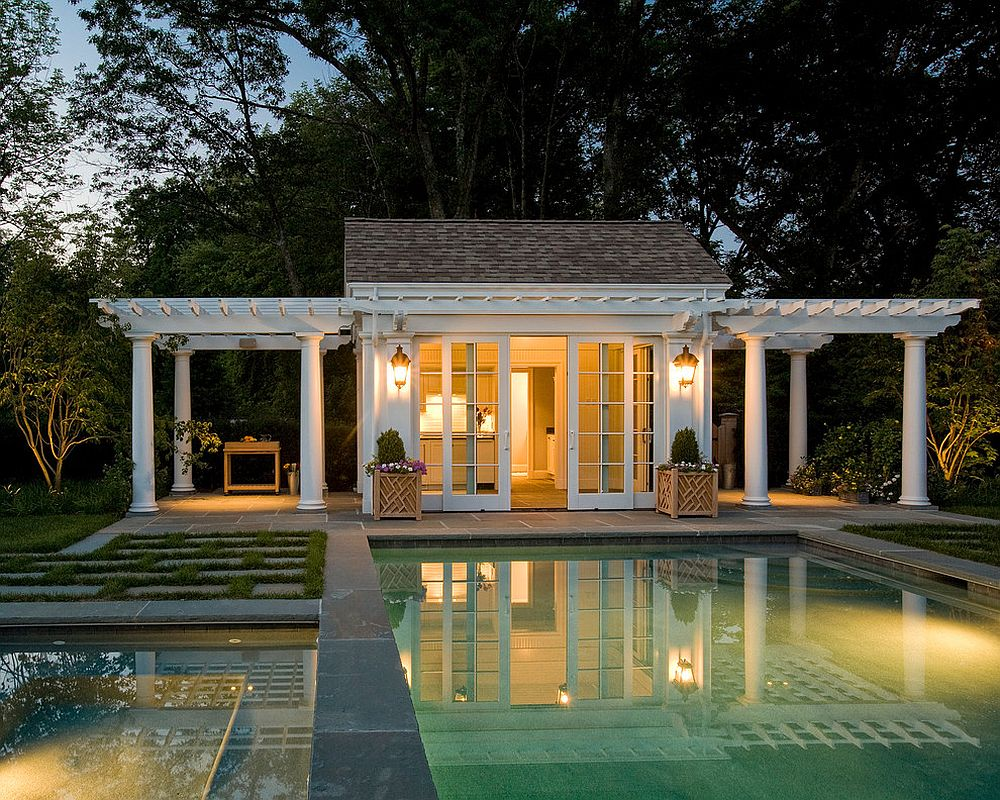 Twin pergolas add elegance to the classic pool house [Design: Merrimack Design Architects]