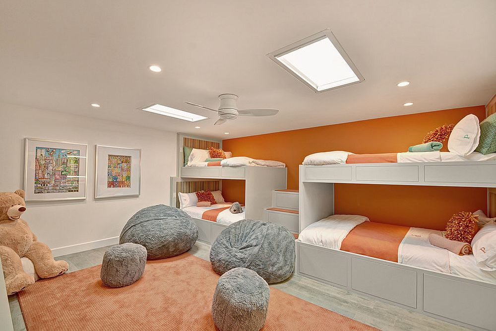 Wall of bunk beds in orange for the kids' room