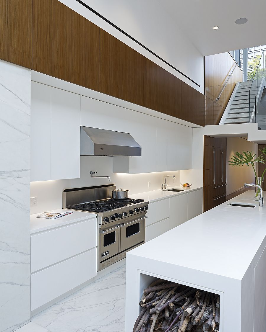 Contemporary kitchen with sixteen-foot-long Corian kitchen island