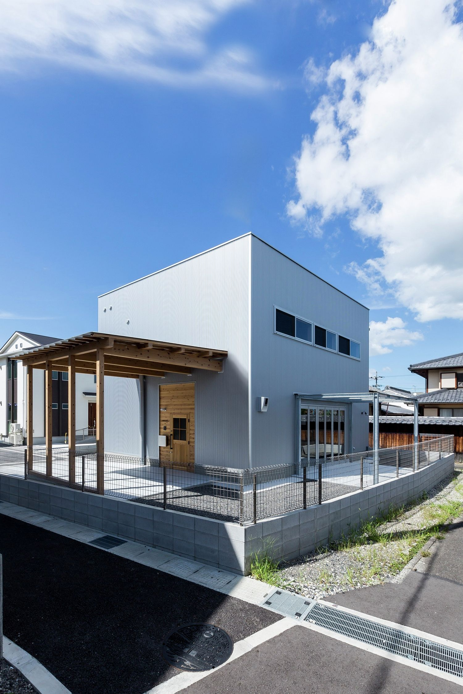 Cubic exterior of the contemporary home draws inspiration from old warehouses