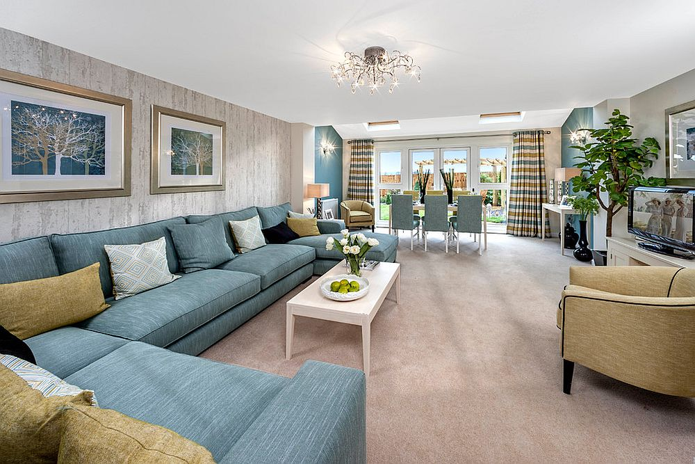 Large sectional in light blue is perfect for the cool contemporary living room [Design: HomeSmiths]