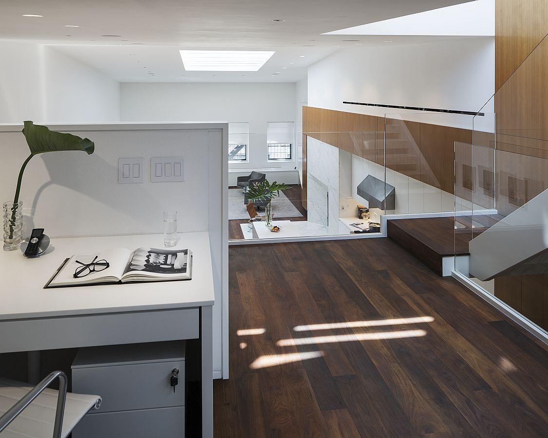 Mezzanine level workspace that overlooks the living area