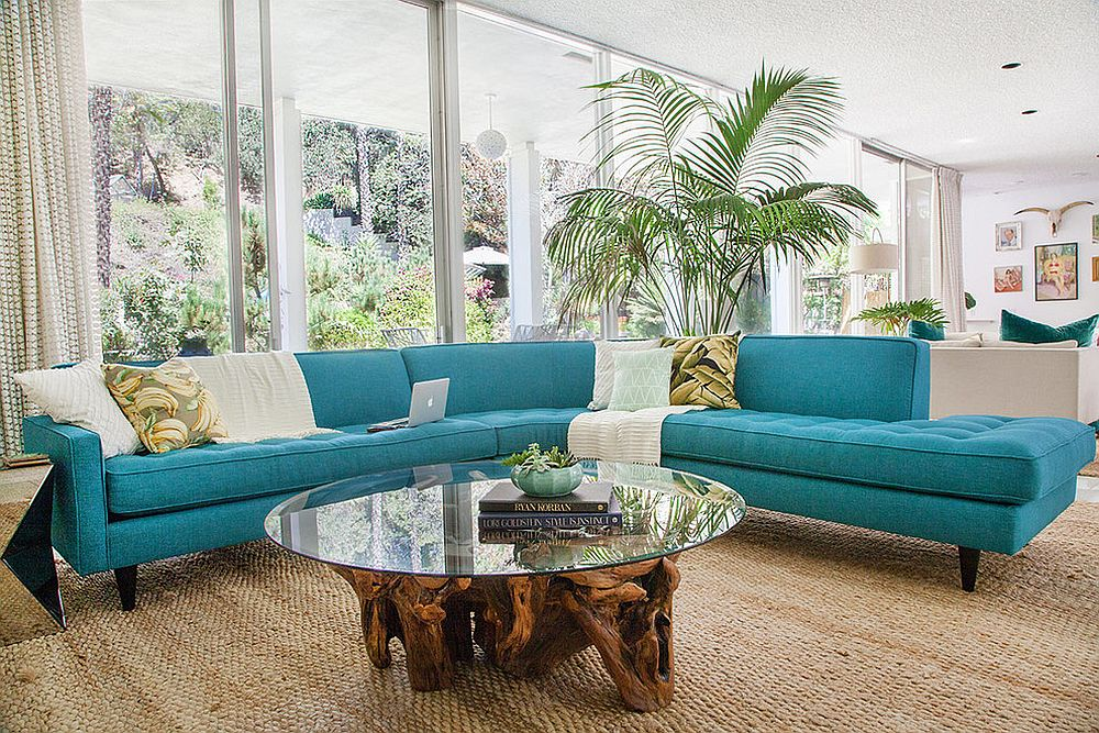 Midcentury family room with striking couch in turquoise and a cool coffee table