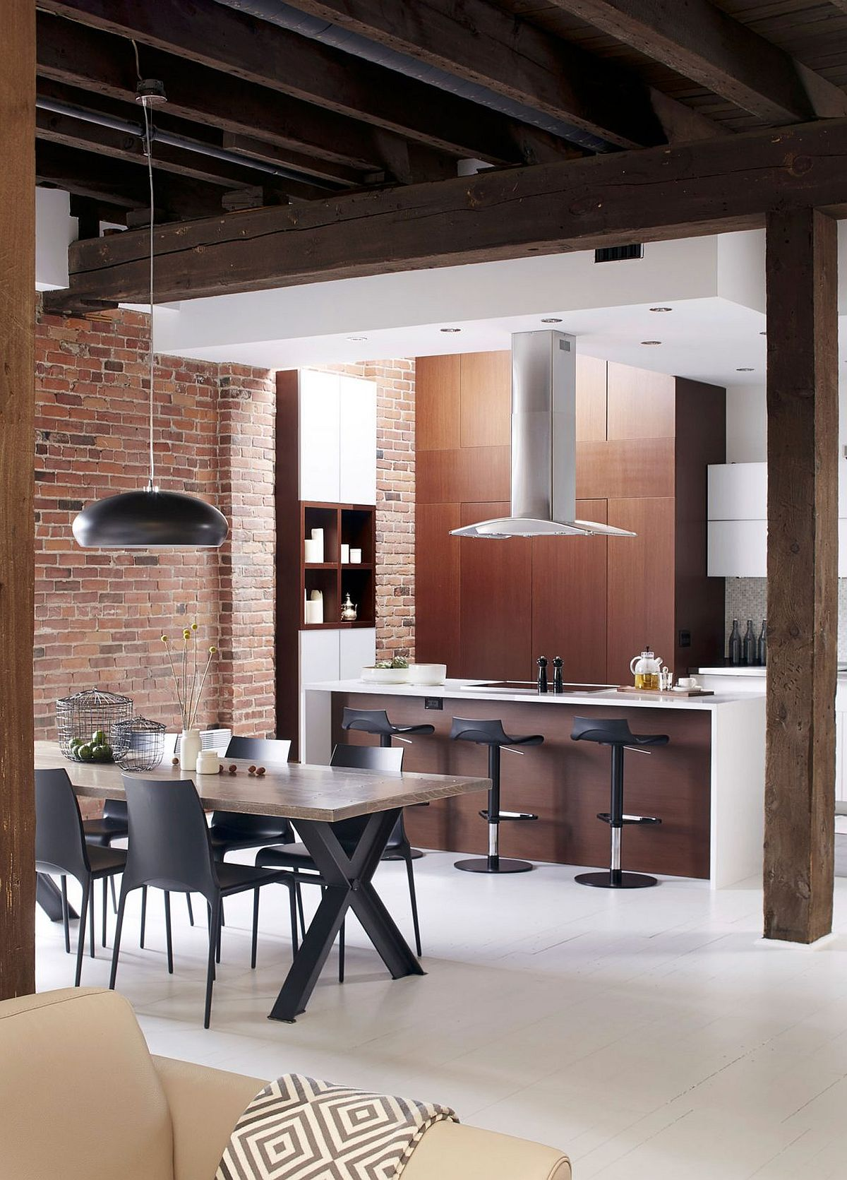 Modern industrial kitchen and dining room of Montreal home
