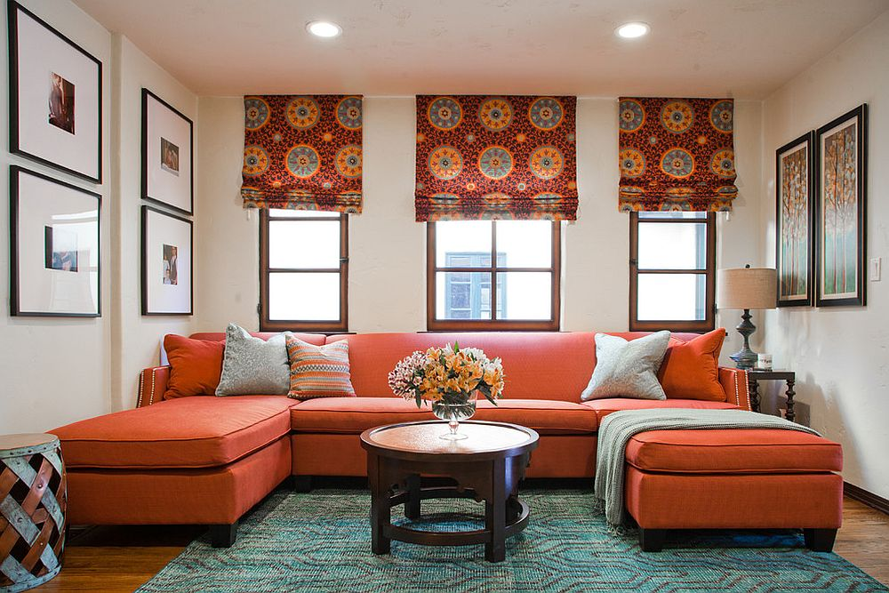Rug adds subtle pattern to the living room with bold orange couch [Design: A. Peltier Interiors]