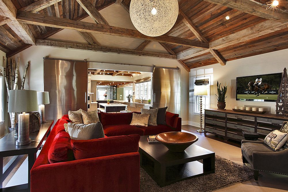 Rustic living room with red couch and spacious interior [Design: Callaway Architects]