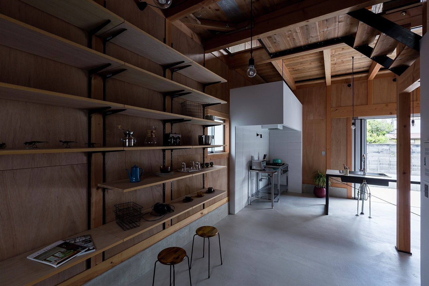 Sleek wooden shelves and open spaces offer flexible and minimal living environment