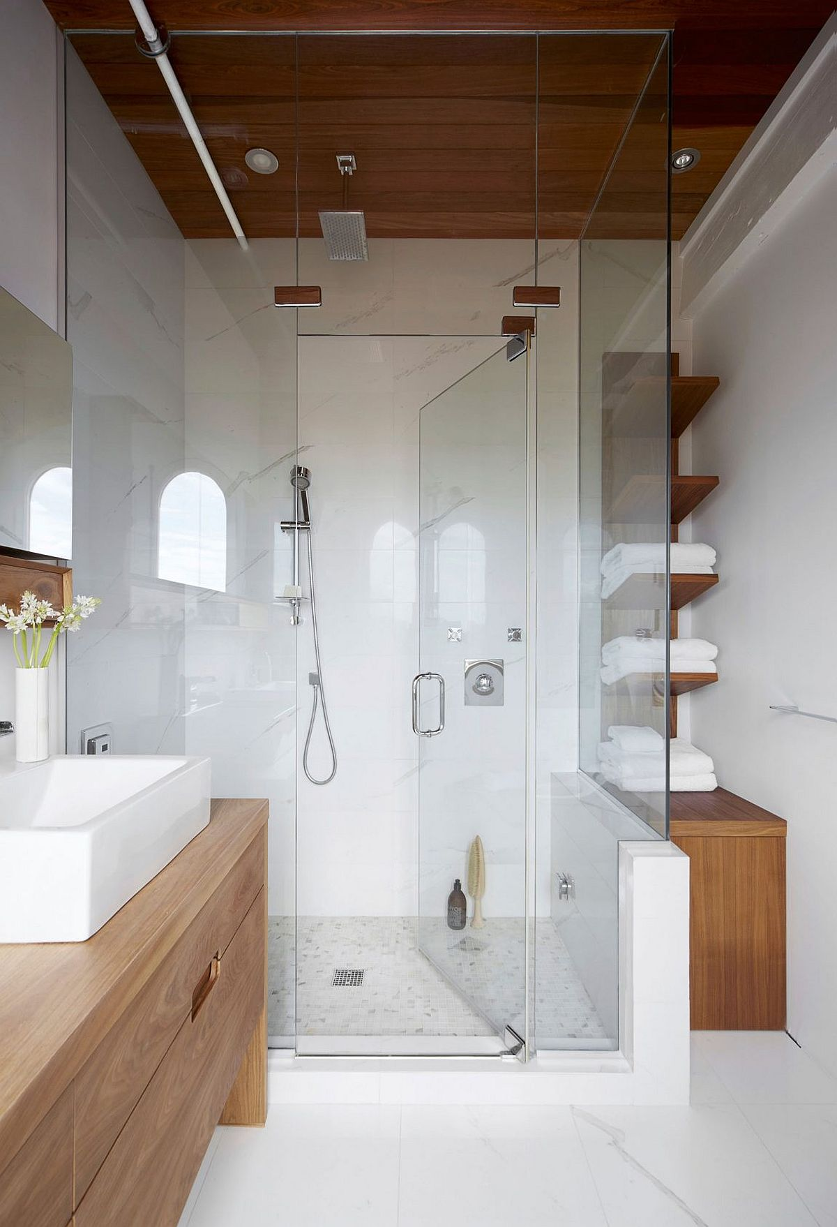 Small glass shower area of the modern bathroom