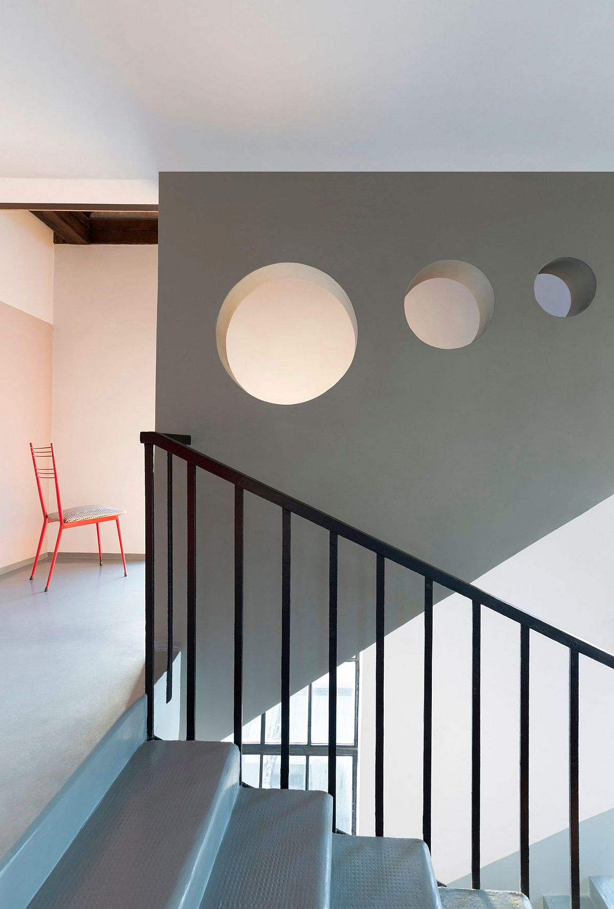 Staircase in gray with openings for light to flow through