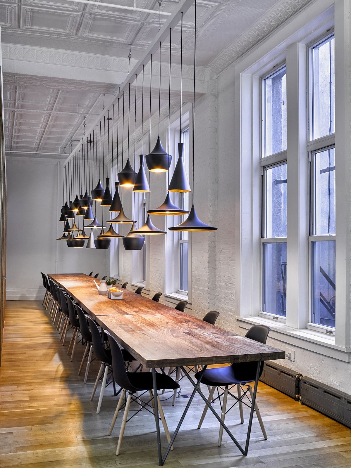 Tom Dixon pendants fit in with the cool style of the smart office