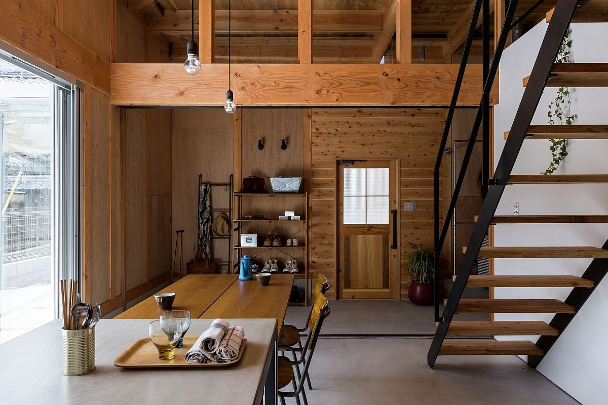 Wood and steel shape the elegant interior of modern Japanese home