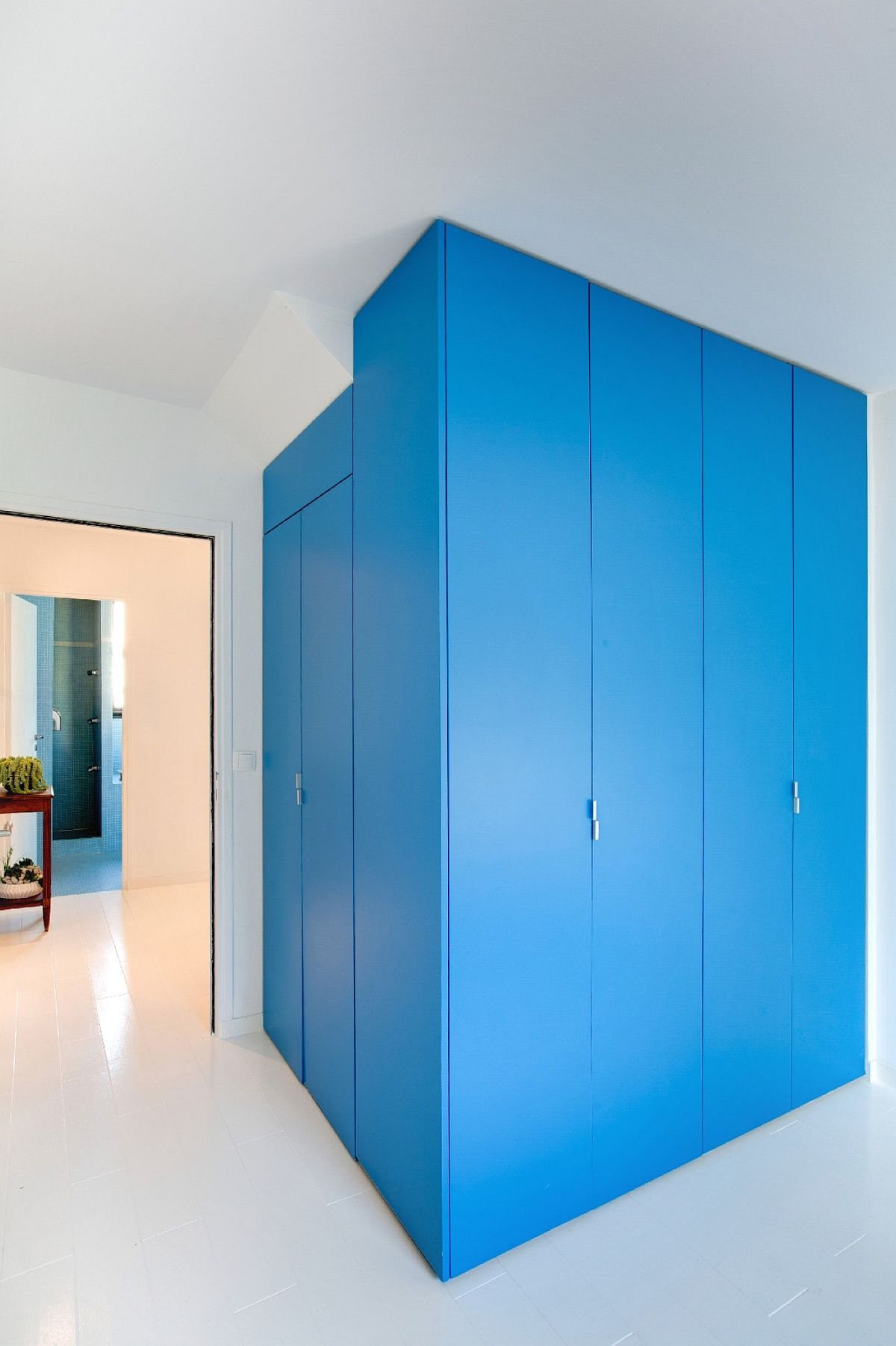 Custom units and smart rooms create a colorful and classy interior