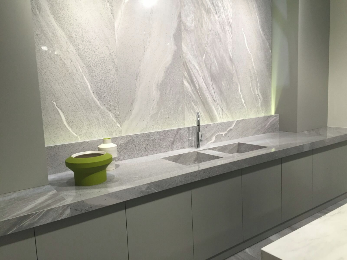 Grey cabinetry meets grey stone