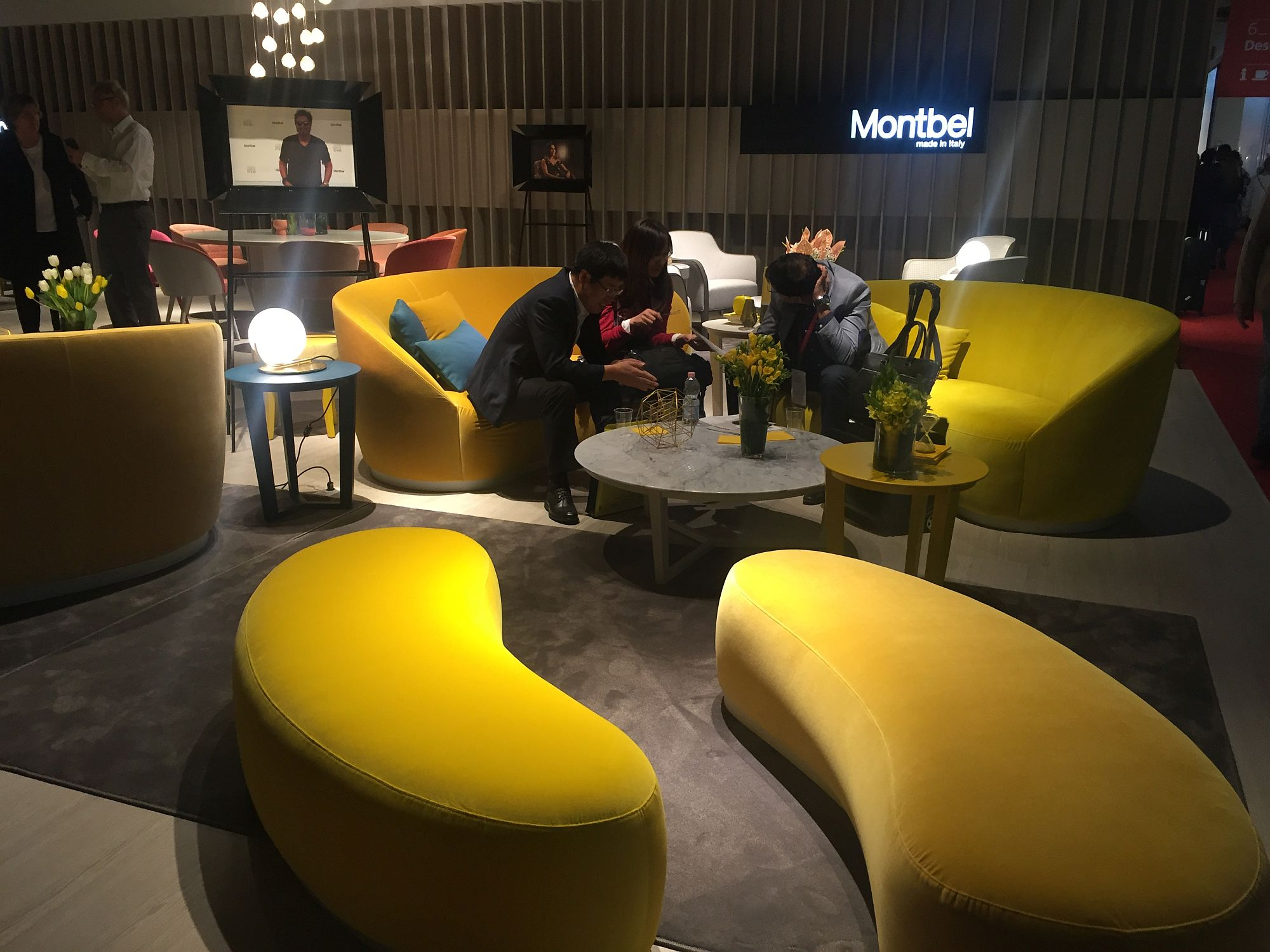 Yellow living room sofas coupled with smart modular setaing that doubles as a coffe table