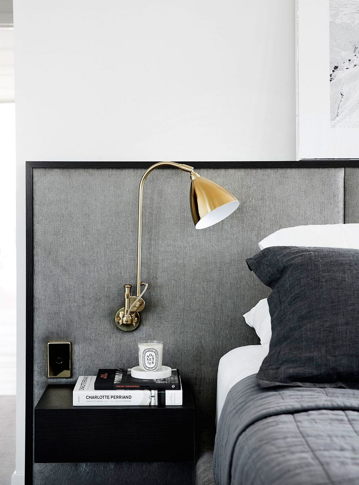 Bedside lamp in gold for the modern bedroom in gray and white