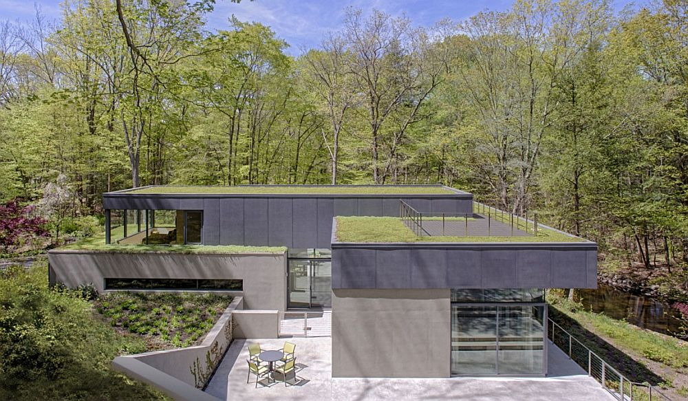 Exquisite roofscape and green terraced planes shape the stunning Lakeside home