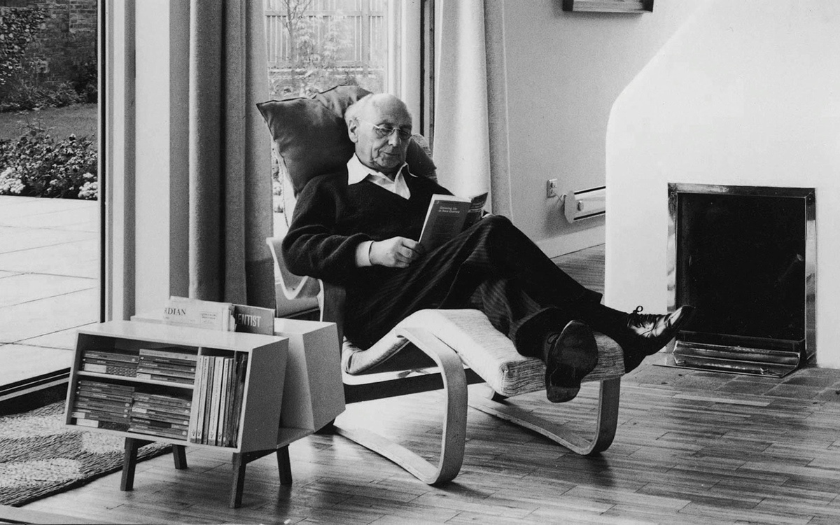 Jack Pritchard in Marcel Breuer's Long Chair with the Ernest Race Isokon Penguin Donkey Mark 2.