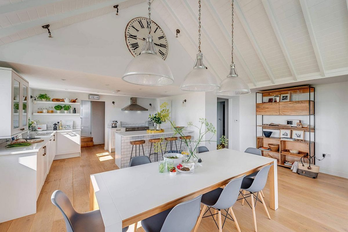 Large clock adds to the coastal style of the fabulous interior in white