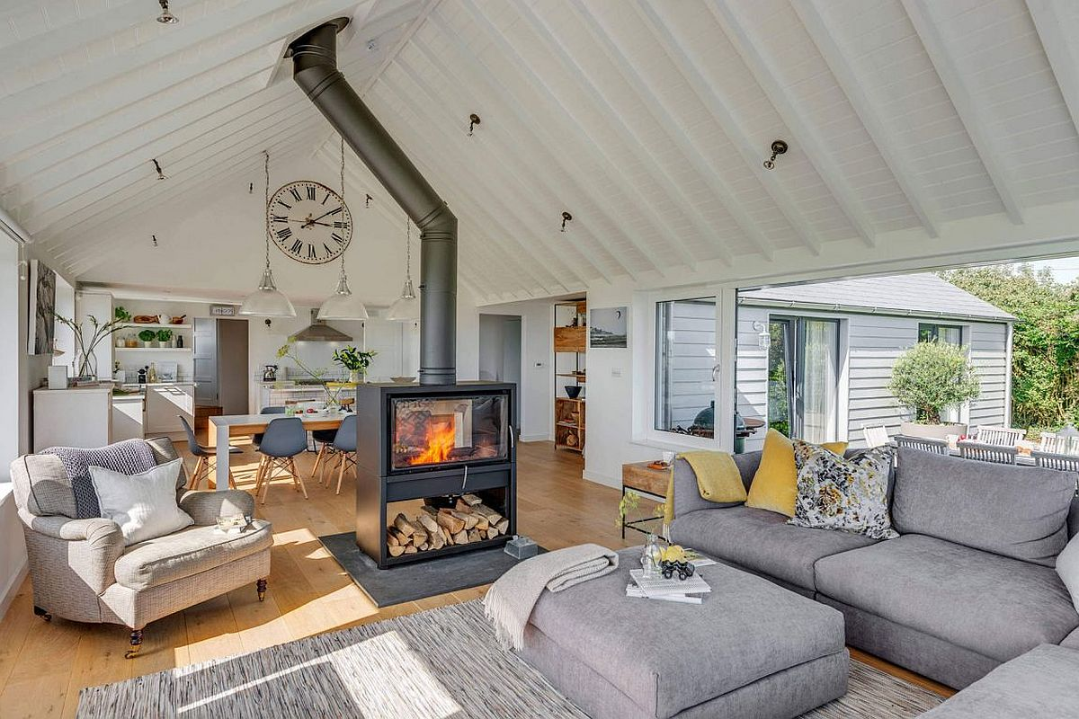 Living room with two sided fireplace of the South Hams Coastal Home