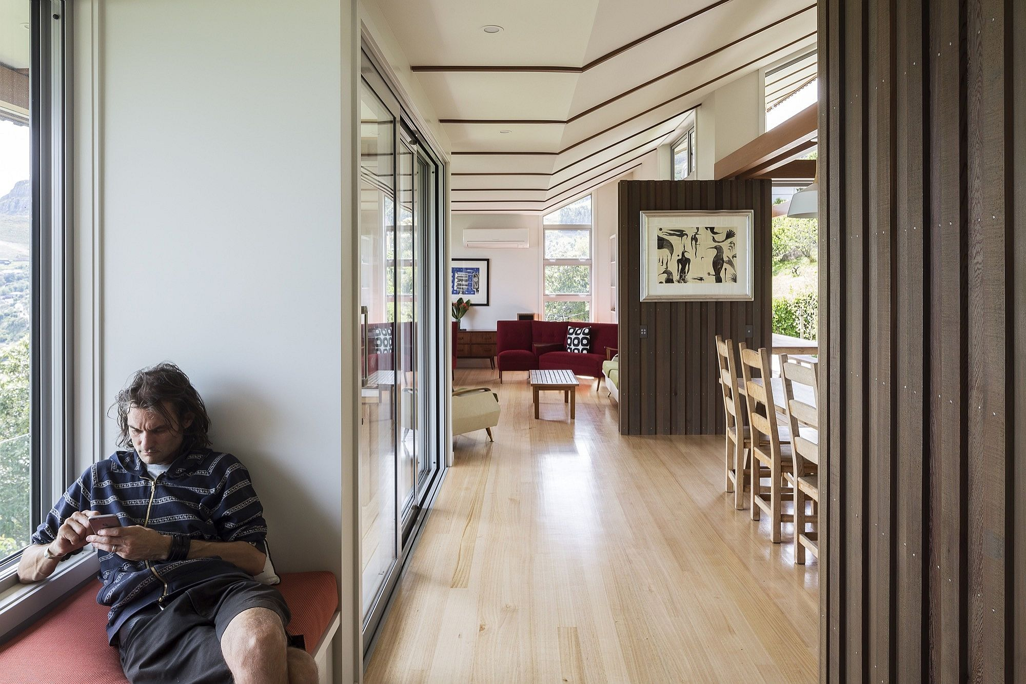 Simple design and a series of large windows open up the house to the view outside
