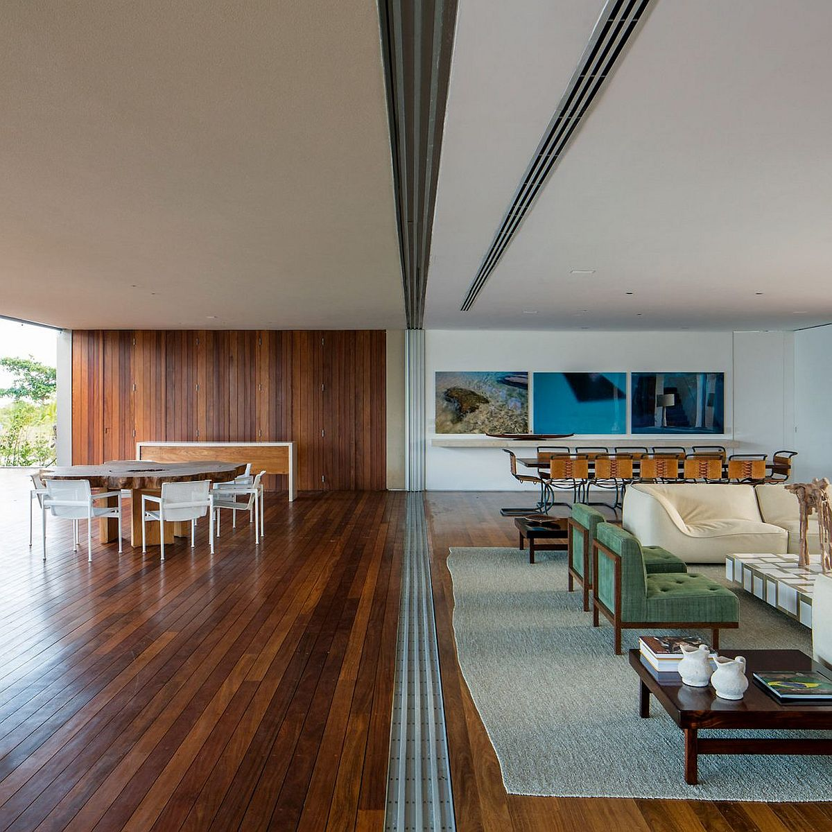 Sliding glass doors disappear into the walls at Casa TM