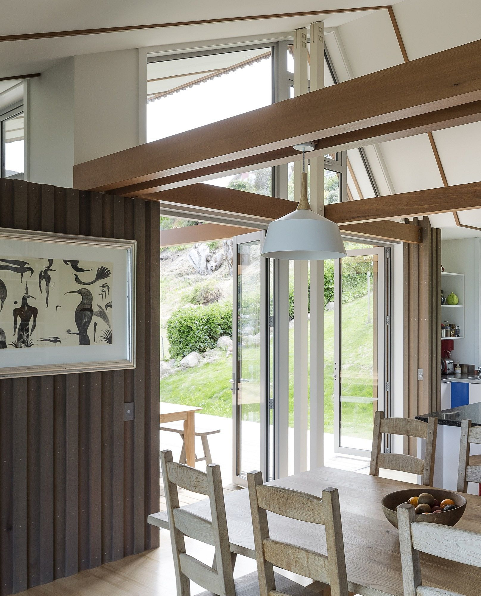 Timber beams of the original villa grace the new house