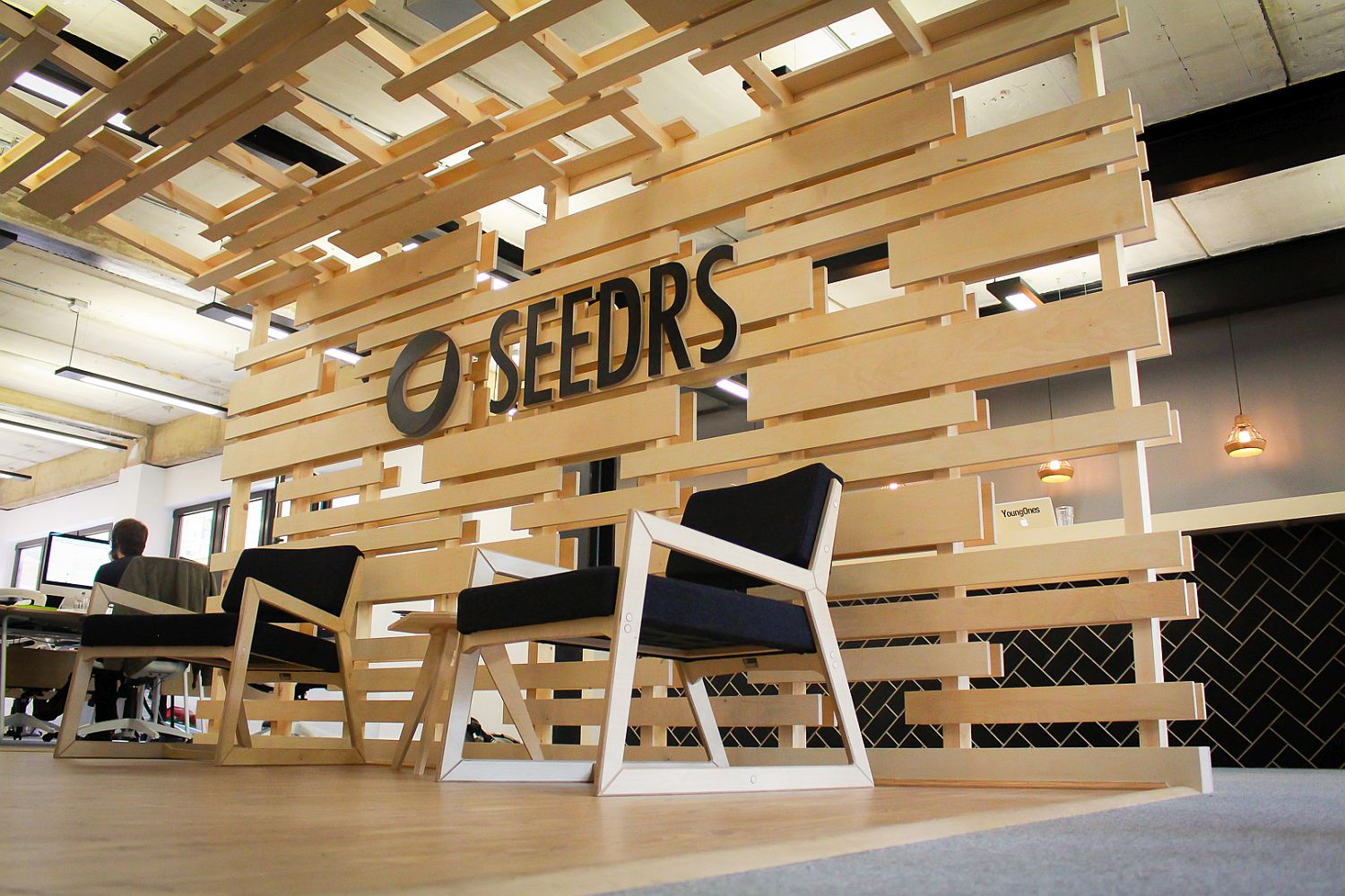 Birch ply backdrop and canopy gives the reception space a smart and cozy look