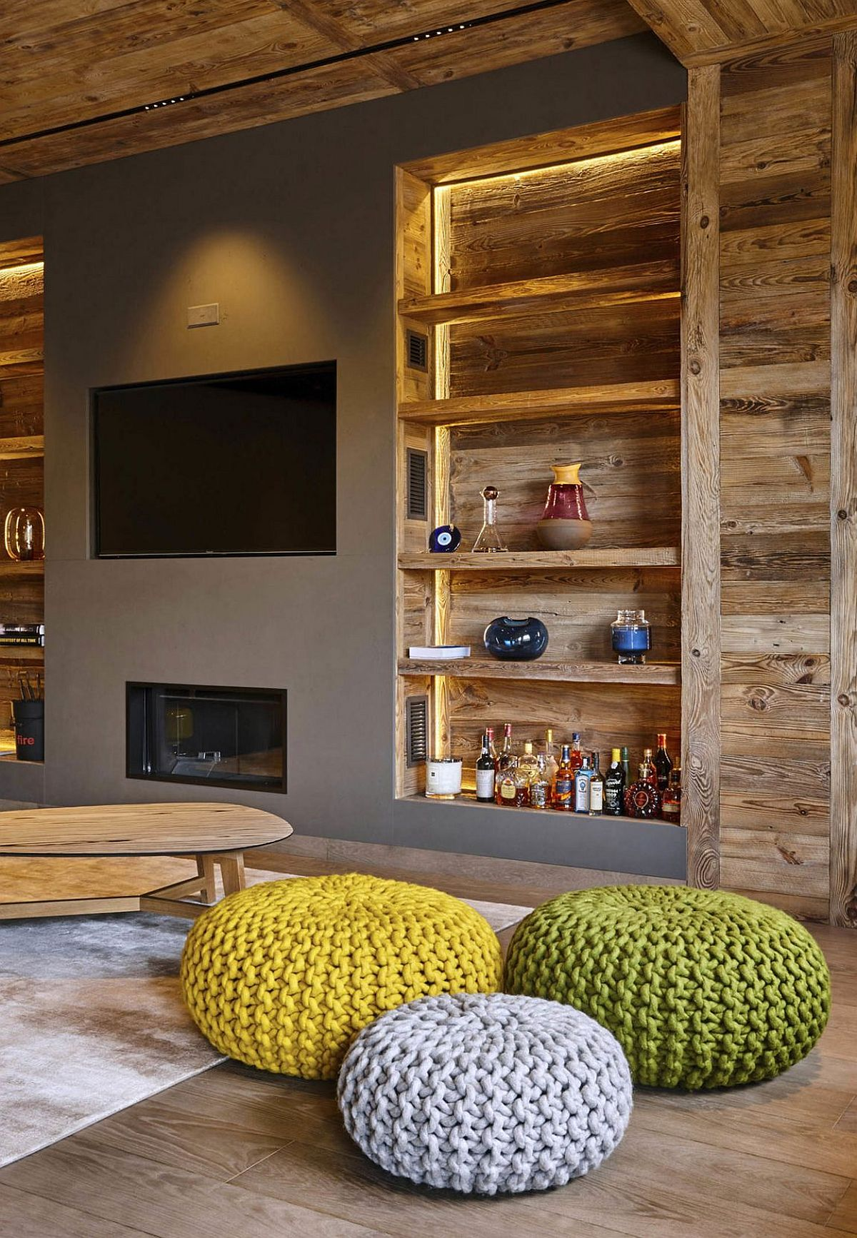 Open wooden shelves next to the TV wall in gray with fireplace below