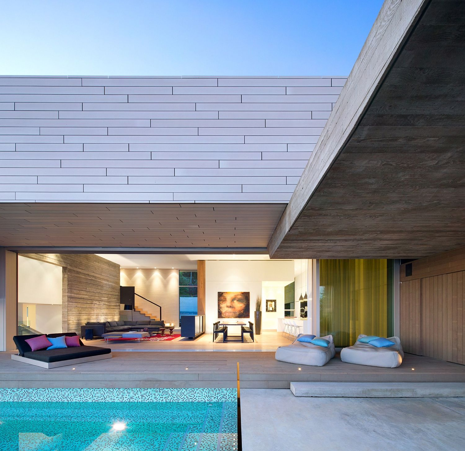 Deck and pool area of the dashing Sunset House in Canada