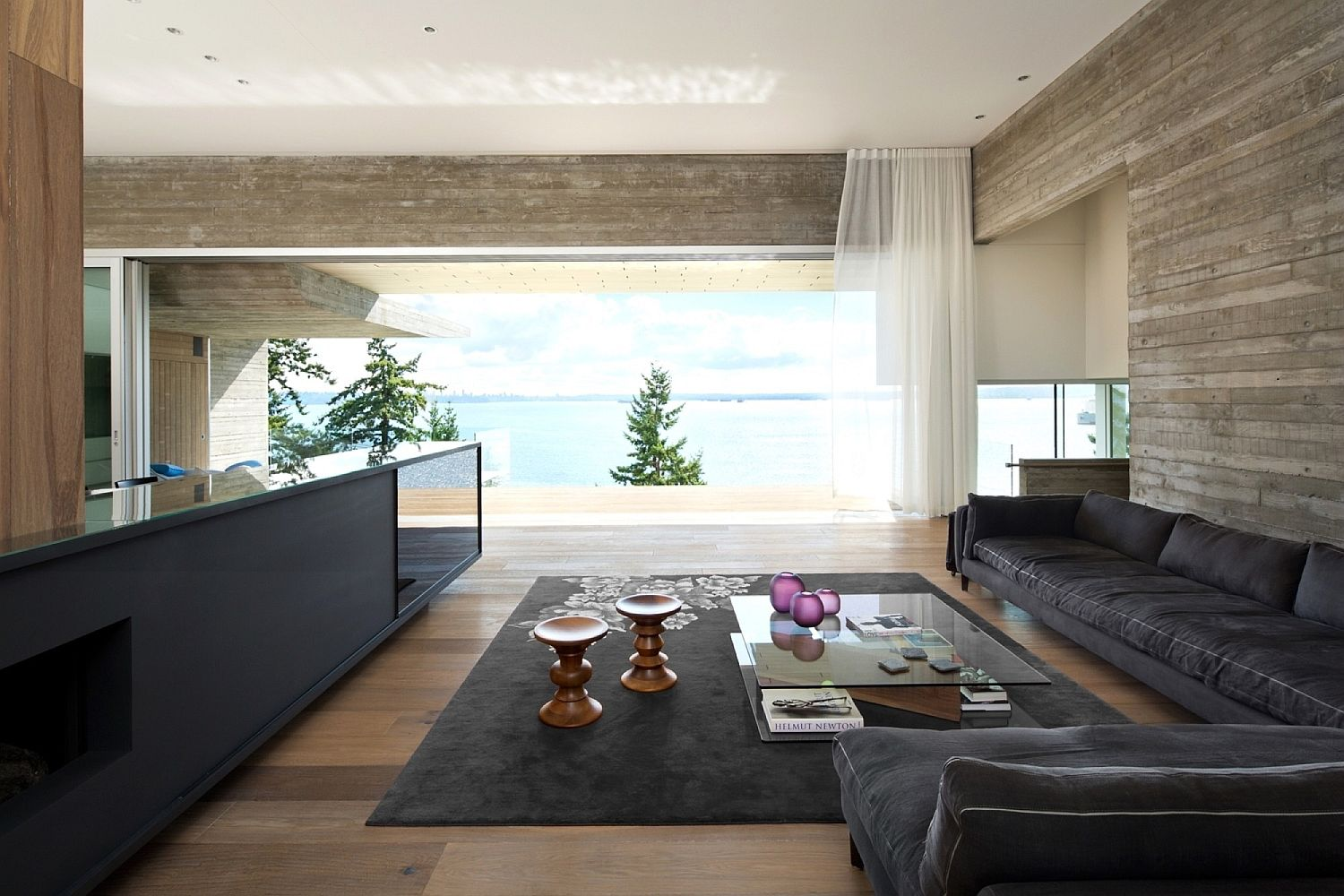 Living area clad in concrete, wood and leather with modern minimalism