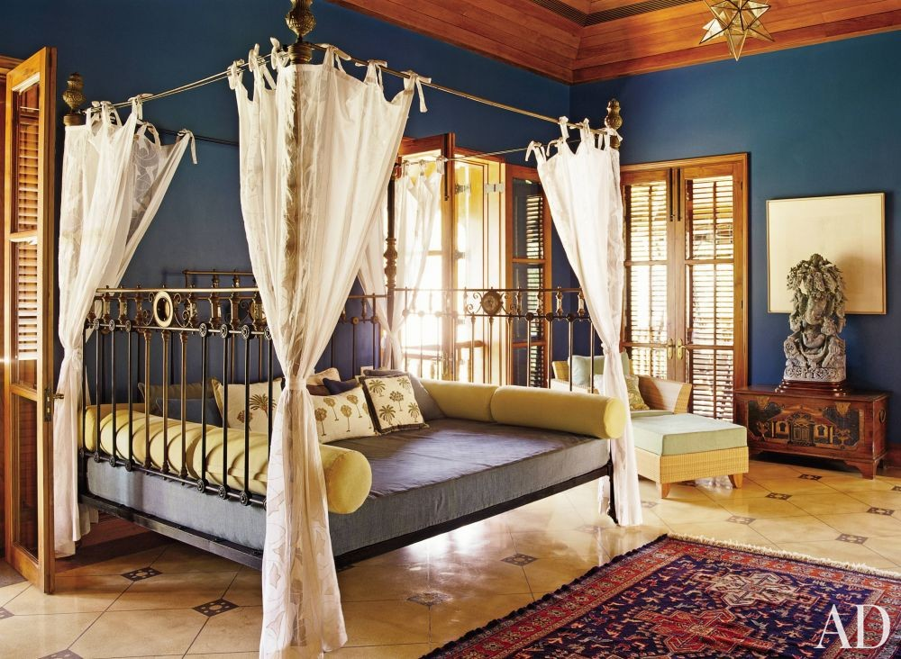 Metallic four poster bed in a bohemian bedroom