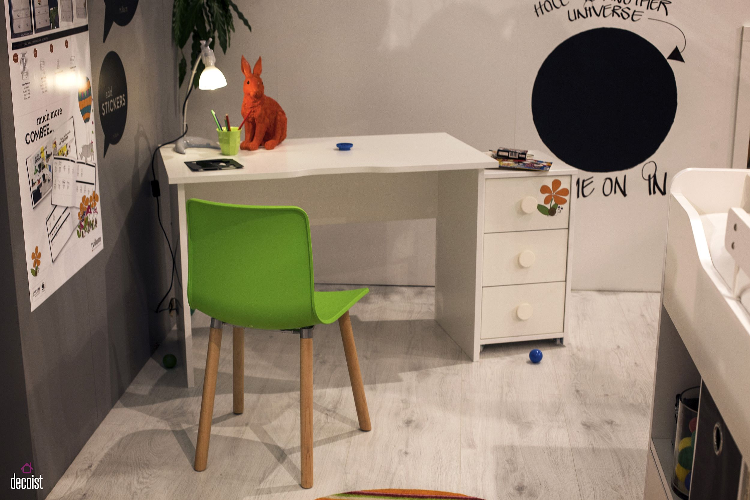 Minimal homeowrk station for the kids' room in the corner with a colorful chair in green and a small cabinet