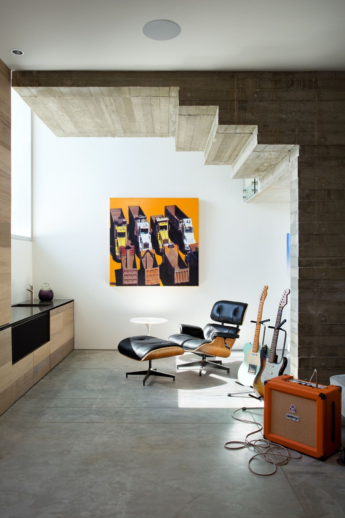 Small recreational and relaxation space under the stairway with the Eames Lounger