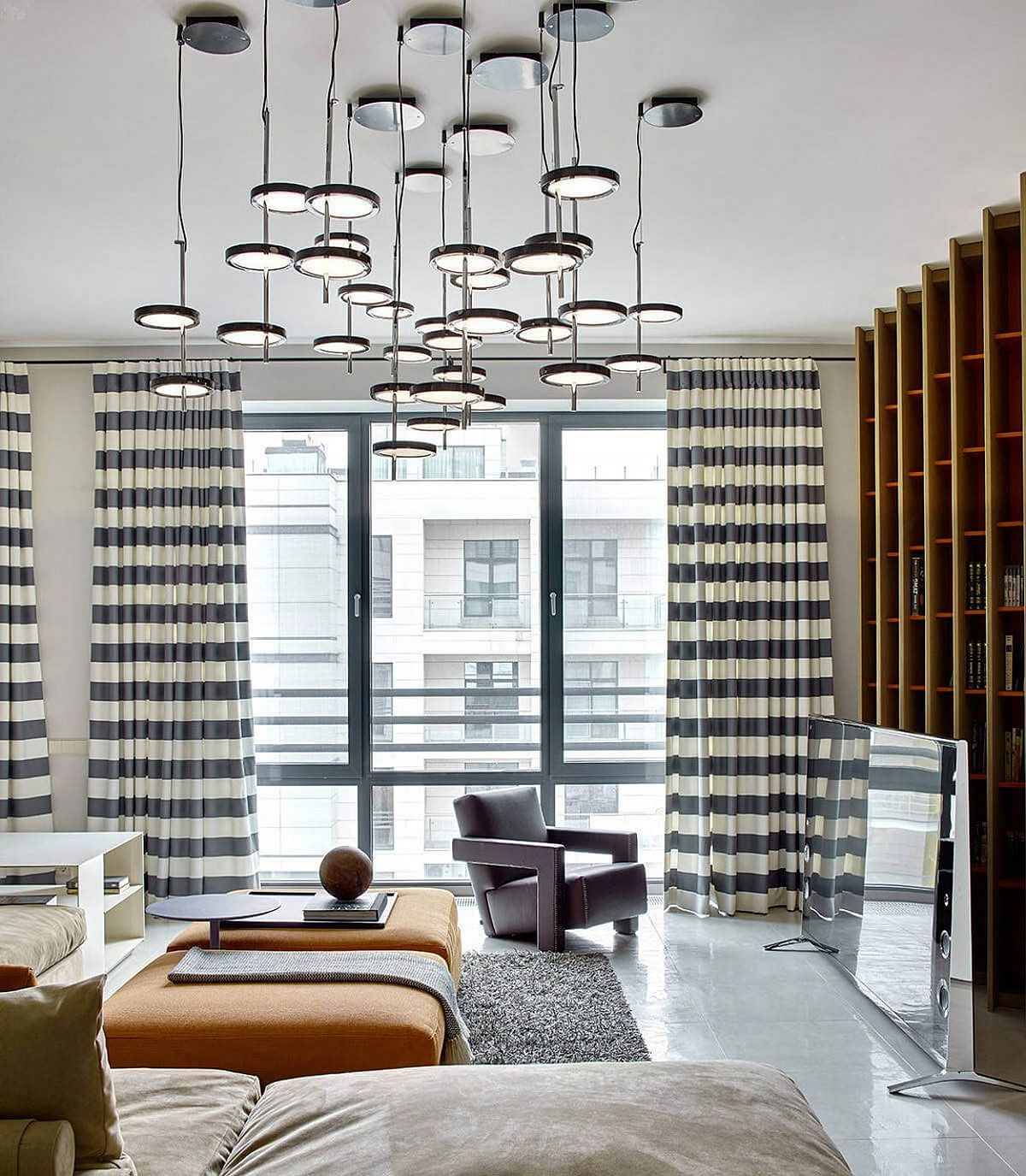 Unique lighting fixture and natural light inside the Russian apartment