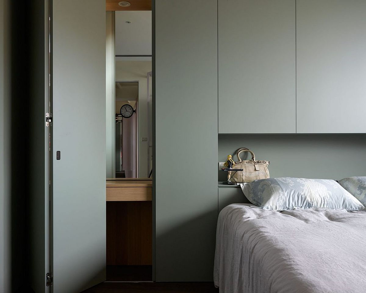 Contemporary bedroom in white with gray shelving
