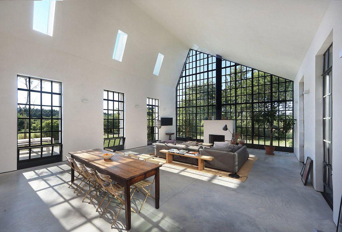 Dark framed windows bring the canopy indoors