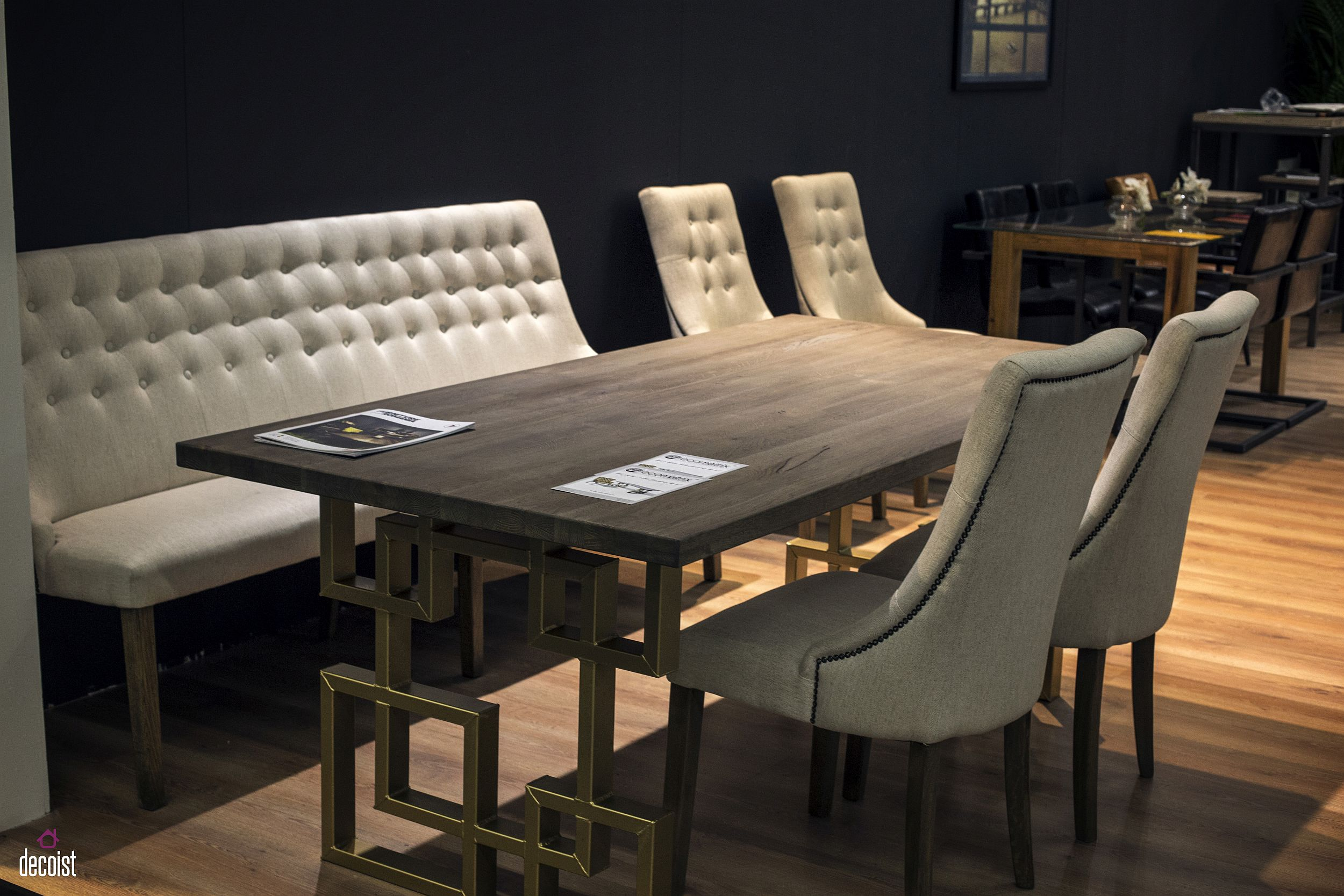 Tufted bench along with comfy chairs for the rustic modern dining room