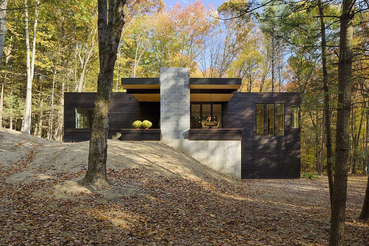 Exposed concrete and cedar shape the facade