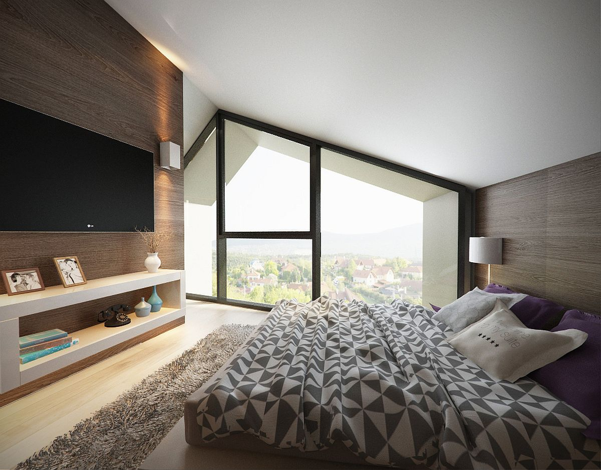 Gabled roof gives the bedroom a distinct slanted ceiling