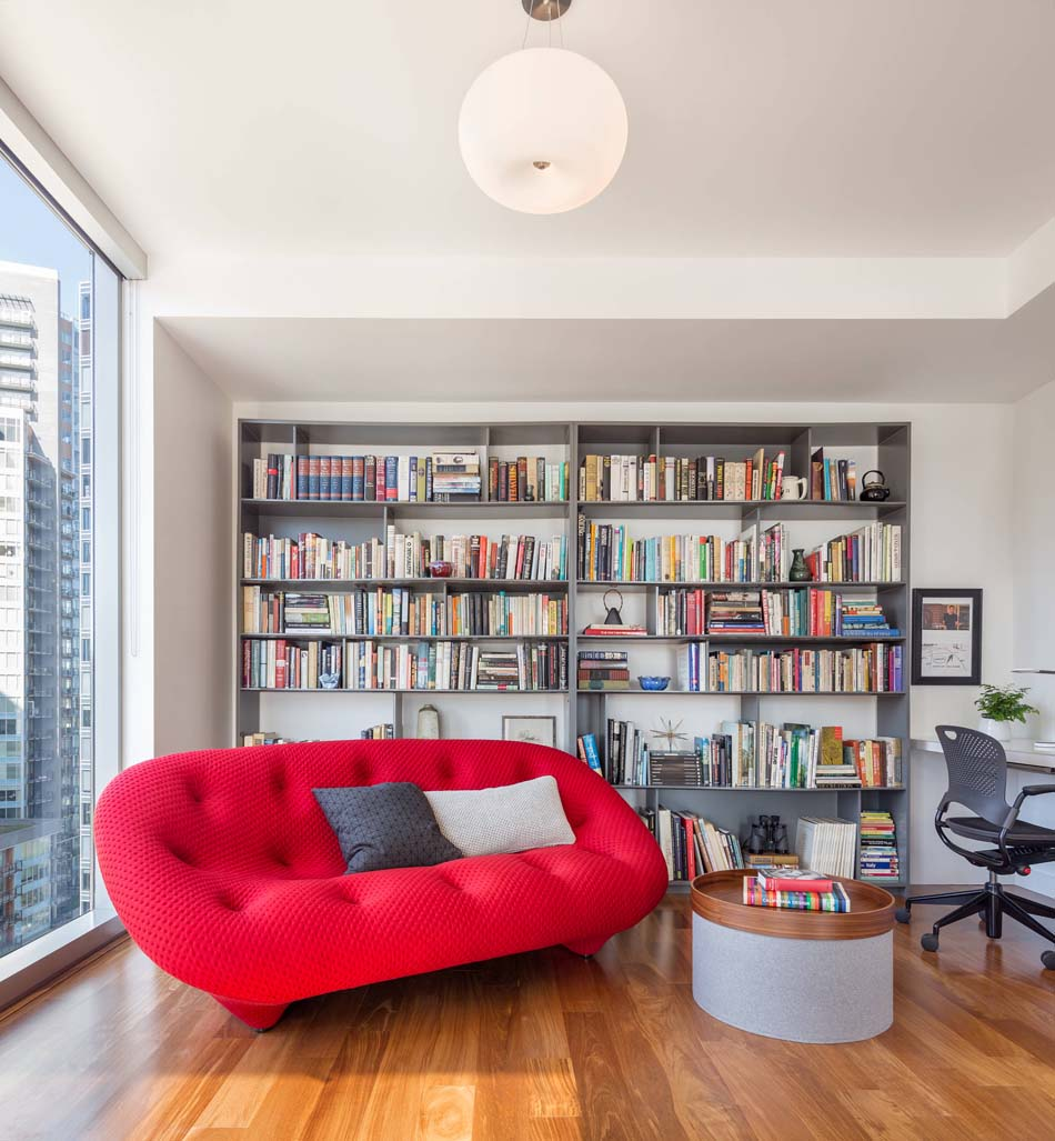 Reading nook with a lively sofa in a bold red color