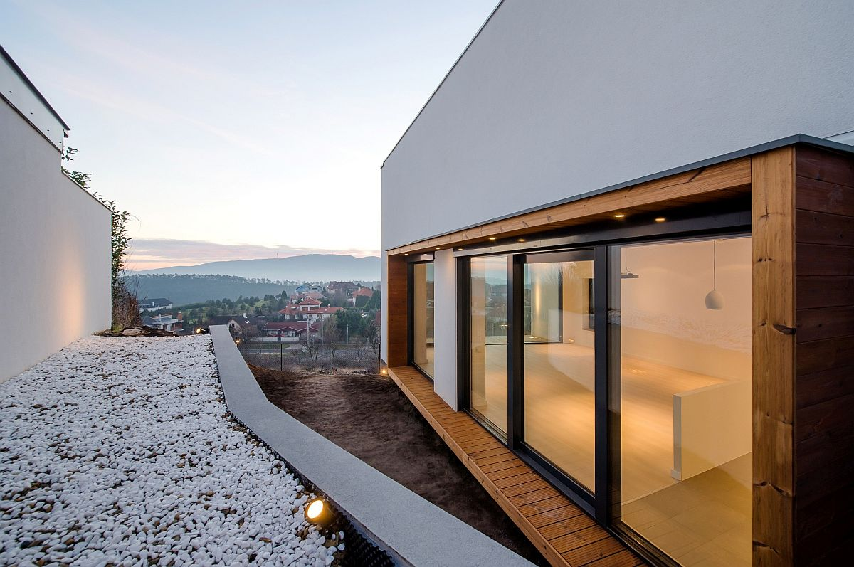 Sliding glass doors open towards the landscape with stunning views