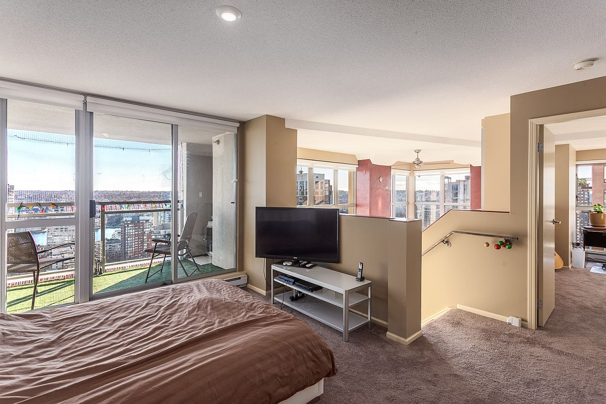 Small balcony next to the bedroom offers spectacular city views