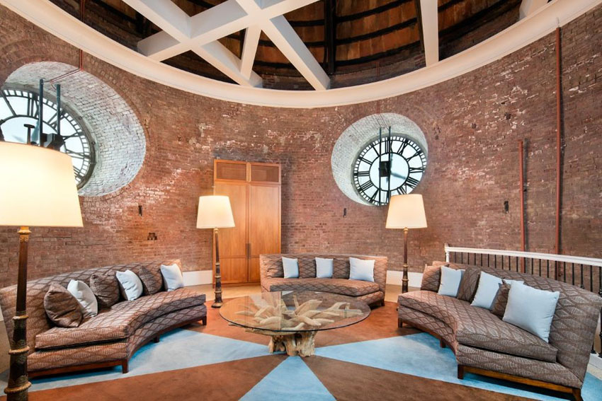 clock tower living room with two round windows