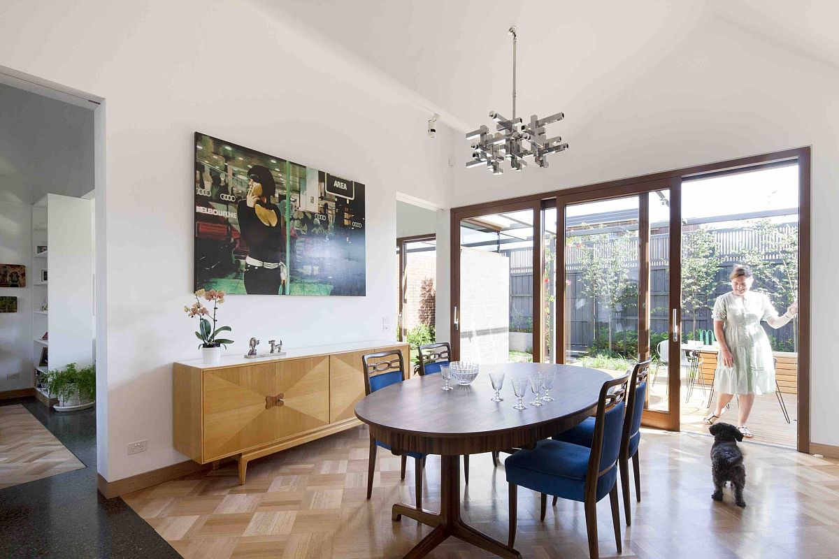 Dining area with wooden flooring to demarcate it from the living space and kitchen
