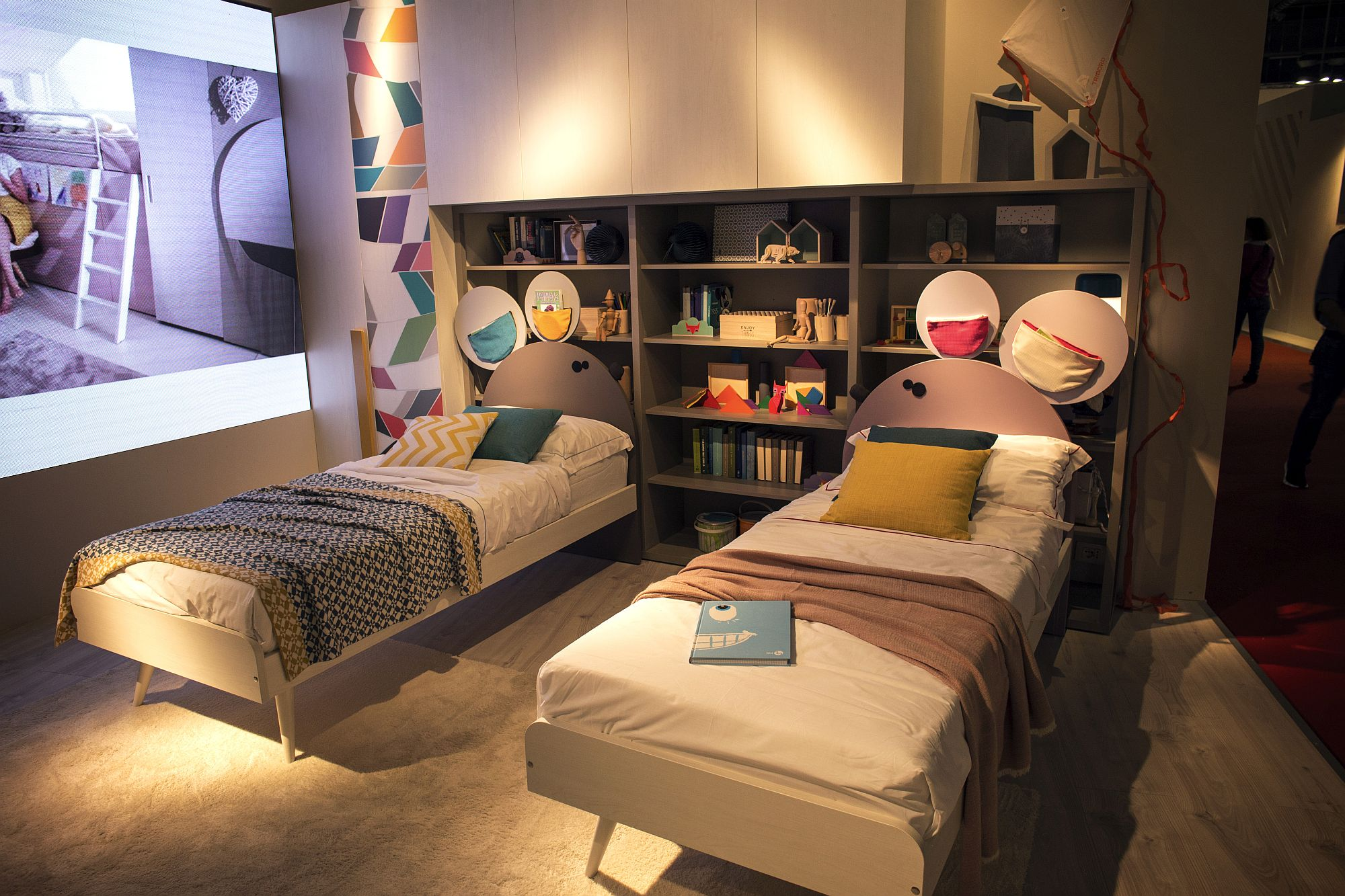 Modest kids' bedroom with twin beds and ample shelf space