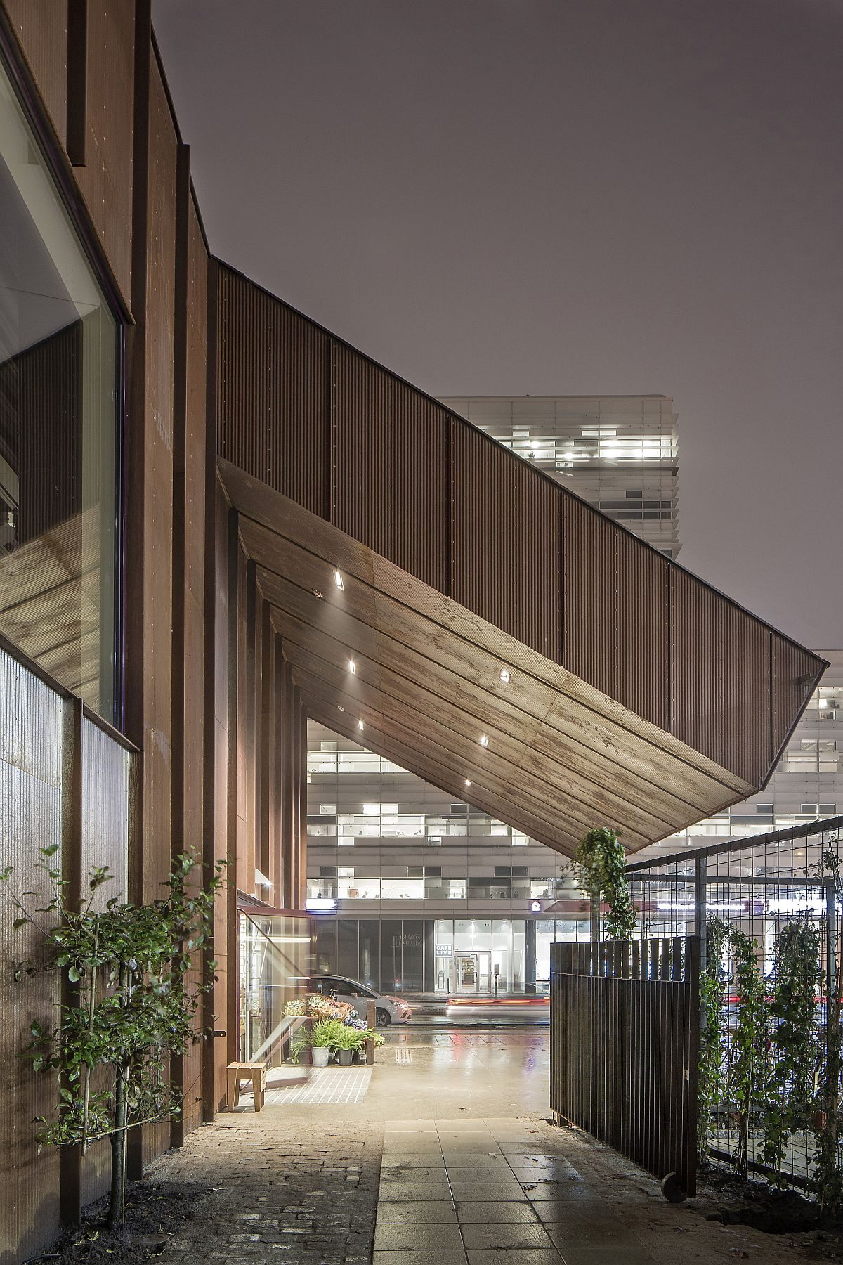 Natural vegetation fills the spaces between the old and new structure
