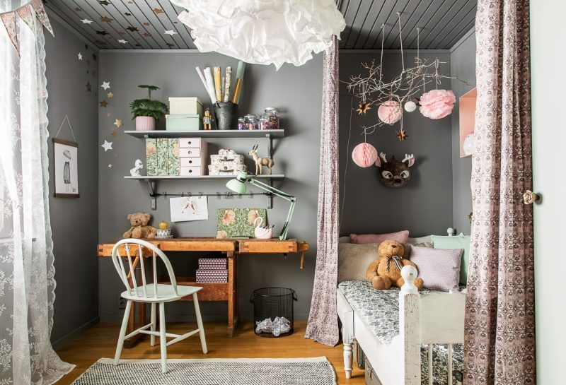 Rustic wooden furniture in a gray and pink bedroom