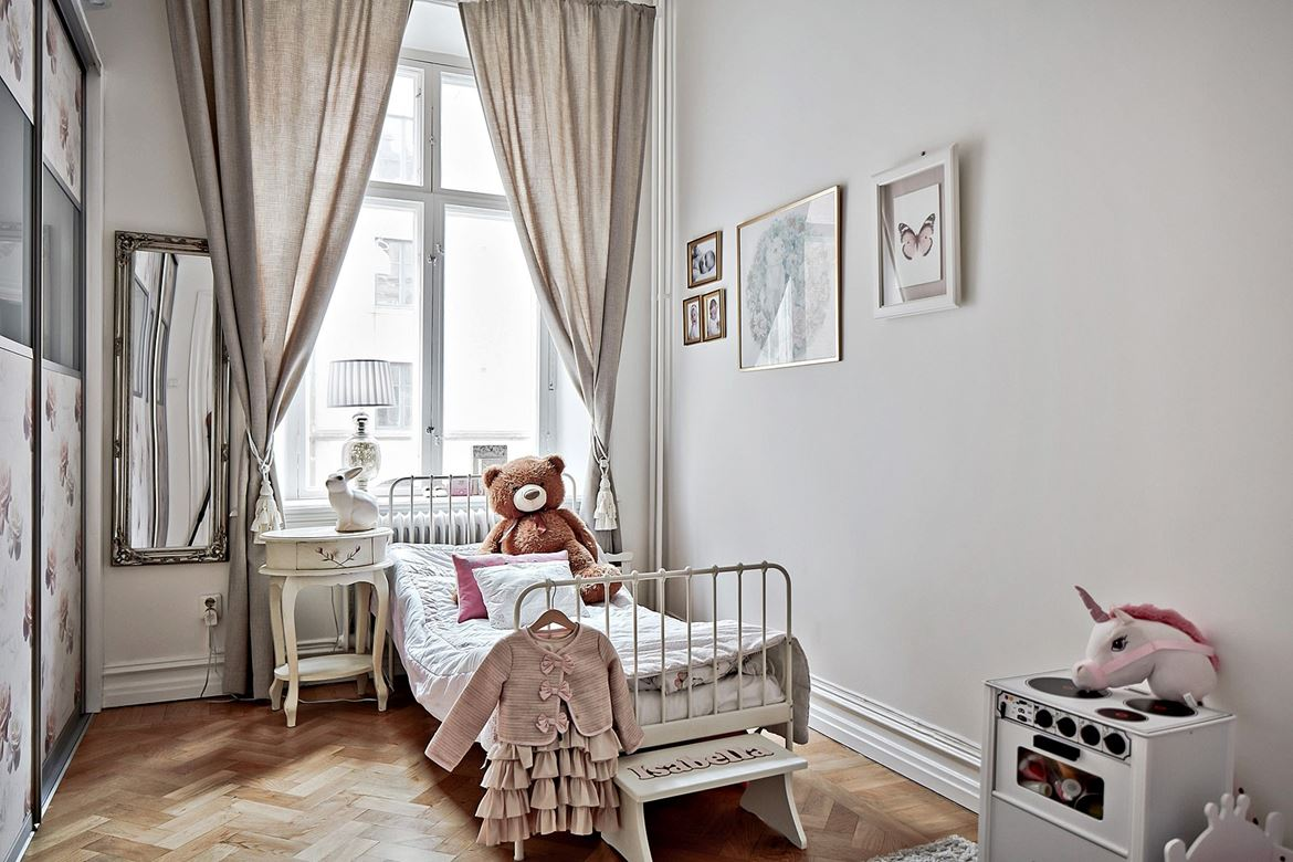 Serene bedroom with a vintage bedside table and a white iron bed