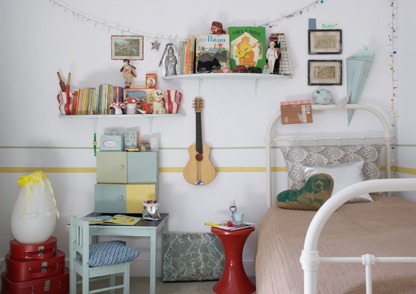 Vintage kids room with beautiful outdated pastel pieces