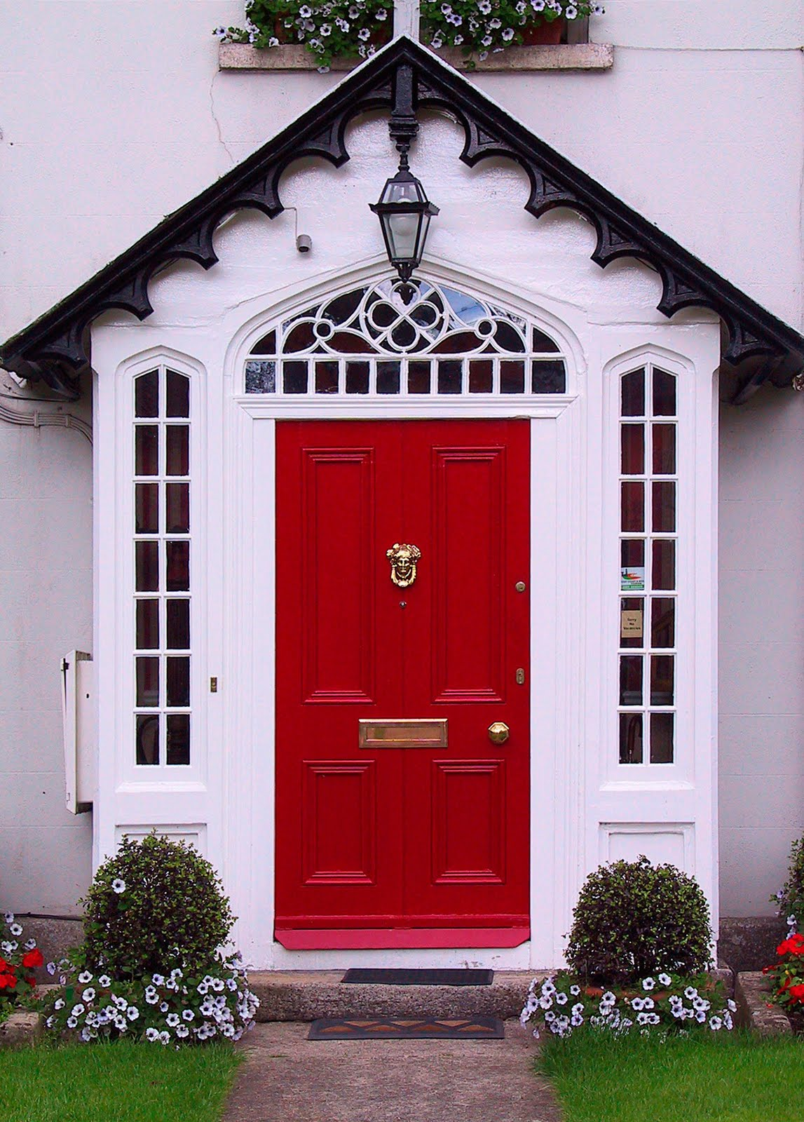 A charming house in light shade of pink with a red door